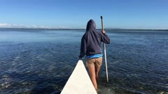 Girl walks with low tide and a Catamaran Boat in Panglao bay Stock Footage