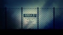 Area 51 Sign on a Metal Fence on a Stormy Night Stock Footage