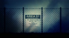 Zoom in into an Area 51 Sign on a Metal Fence on a Stormy Night Stock Footage