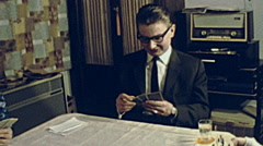 Austria 1962: people playing cards at home Stock Footage