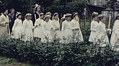 Austria 1962: little girls entering into the church on the first communion day Stock Footage