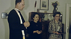 Austria 1962: priest praying at home with two woman - stock footage