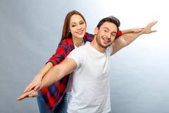 Vivacious couple having fun in the grey background Stock Photos