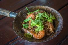 Baked shrimps with glass noodles, authentic Thai cuisine - stock photo