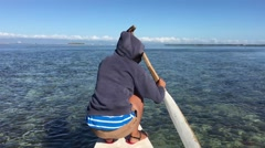 Girl paddles with low tide at a Catamaran Boat in Panglao bay Stock Footage