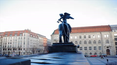 Dolly in to Berlin Konzerthaus angel lion statue, Gendarmenmarkt, Germany Stock Footage