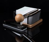 wooden stationery set with silver pen isolated on dark background - stock photo