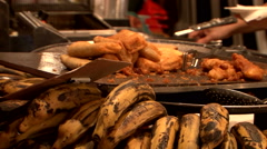 Baka bana baked banana asian food Stock Footage