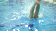 Unrecognizable man diving in the swimming pool. Slow motion close up shot Stock Footage