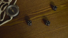 Seaman plays dice on old wooden table with a compass - stock footage