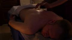 Hands of the masseur doing massage back men Stock Footage