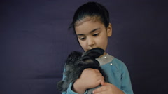 Little girl hugging a fluffy bunny Stock Footage