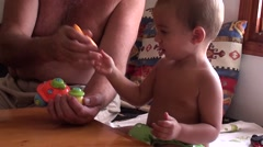 Zoom in granddad giving master class to his grandson- - stock footage