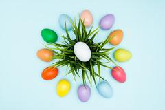 Colorful easter eggs arranged in a circular - stock photo