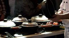 Chef s kitchen black pan baking Stock Footage