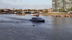 Ferry arriving at Chelsea harbour, River Thames,  London, UK Stock Footage