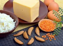 Food high in protein on table. Stock Photos