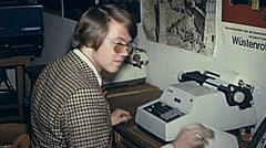 Austria 1970: young man at the typewriter - stock footage
