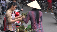 Local street food market, vendor selling vegetables, conical hat, Hanoi, Vietnam Stock Footage