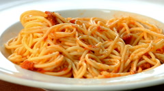 Fresh, cooked pasta, served on a plate. Close up, front view with a fork. Stock Footage