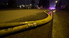 Fire Hoses At Night - stock footage