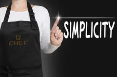 simplicity touchscreen is operated by chef - stock photo