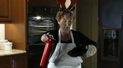 Kitchen Disasters, Woman with Apron and Reindeer Antlers - stock footage