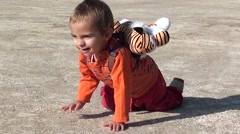 Child is crawling on cement site Stock Footage