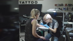 Getting First Tattoo in Studio Stock Footage