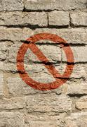 Grungy urban wall with forbidden sign - stock photo