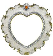 Gilded photo frame inlaid with rhinestones in form of heart - stock photo