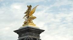 Alexander III bridge golden statues in Paris France Stock Footage