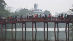 Tourists visit the Huc bridge at Hoan Kiem lake in Hanoi, Vietnam Stock Footage