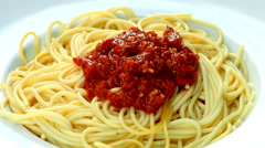 Fresh, cooked pasta, served on a plate with tomato sauce, decorating it with par - stock footage
