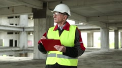 Supervisory personnel at construction site Stock Footage