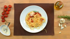Fresh, cooked pasta, served on a plate. Top view of decorated table with tomatoe Stock Footage