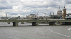 Boat sailing towards the Cannon Street Railway Bridge in London Stock Footage