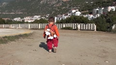 Child with a lionet backpack walking away Stock Footage