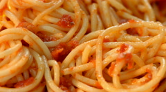 Fresh, cooked pasta, served on a plate. Close up of cooked spaghetti with tomato Stock Footage