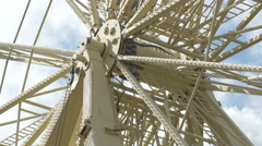 View of a white ferris wheel mechanism in London Stock Footage