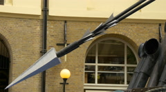 Old boat with large spear displayed at Hay's Galleria in London - stock footage