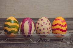 Colorful Easter Eggs on Wood Board Background - stock photo
