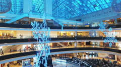 Buyers and people walking in the Interior AFIMALL CITY in Moscow Stock Footage