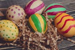 Colorful Easter Eggs on Wood Board Background Kuvituskuvat