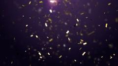 Golden confetti falling down - stock footage