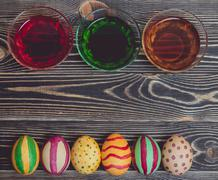 Colorful Easter Eggs on Wood Board Background Stock Photos