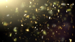 Golden confetti falling down Stock Footage