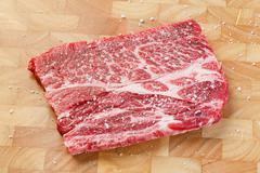 Beef chuck steak with sea salt Stock Photos