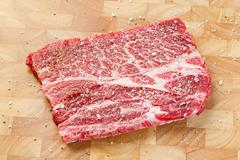 Beef chuck steak with sea salt and pepper - stock photo