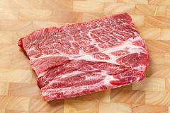 Beef chuck steak on chopping board Stock Photos